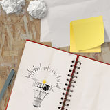 Note book with hand drawn light bulb and THINK word design Royalty Free Stock Photos