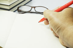 Note Book, Hand and glasses Stock Photos