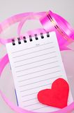 Note book and heart Stock Photos