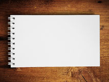 Note book horizontal on teak wood Stock Image