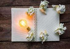 Note book and light bulb Royalty Free Stock Images