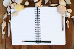 Note book. Notebook on wood table with thinking and write Stock Photography