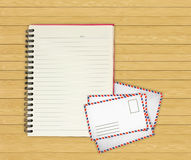 Note book with Old envelopes on wooden Stock Images