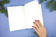 Open notebook on a purple background. stock photos