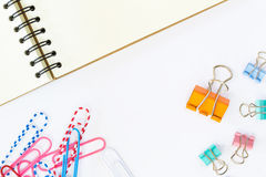Note book and paper clips on white background Royalty Free Stock Image