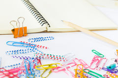 Note book and paper clips on white background Stock Photo