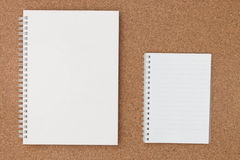 Note book paper on cork board Royalty Free Stock Images