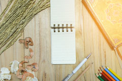 Note book paper notepad for writing information with pen, color pencil, pencil, book and crumpled paper balls Royalty Free Stock Photo