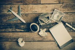 Note book paper on old wooden background ; still life. Royalty Free Stock Photography
