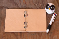 Note book paper and pen and doll wol Royalty Free Stock Images