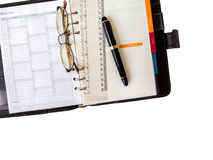 Note book paper with pen and glasses Stock Images