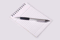 Note book with pen Royalty Free Stock Photos
