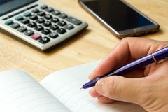Note book with pen,calculator, smart phone. Background Royalty Free Stock Images