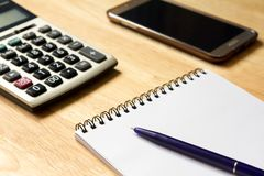 Note book with pen,calculator, smart phone. Background Royalty Free Stock Image