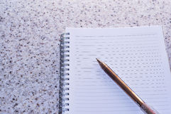 Note book with pen.conceptual design. Note book with pen on the table Stock Image