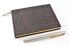 Note book and pen. Note book and fountain pen Stock Images