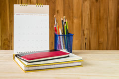 Free Note Book,pen,pencil And Stack Of Book With Calendar On Wooden T Stock Image - 73335381