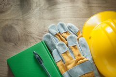 Note-book pen protective gloves building helmet Royalty Free Stock Images