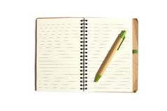 Note book with pen on a white background. Note book with pen, isolated on white Stock Photo
