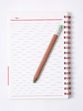 Note book with pencil,. White background Stock Images