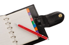 Note book and pencil Stock Image