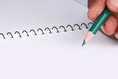 Note book with pencil Stock Photography