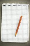 Note book and pencil royalty free stock image