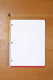 A note book and pencil on a desk Royalty Free Stock Images