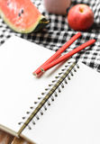 Note book and pencil Royalty Free Stock Images