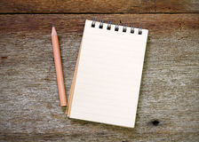 Note book pencil on old wood Royalty Free Stock Photo