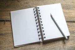 Note book , pencil on old wooden Royalty Free Stock Photo