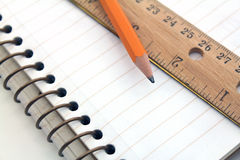 Note book with pencil and ruler Royalty Free Stock Image