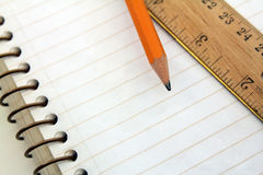 Note book with pencil and ruler Royalty Free Stock Photography