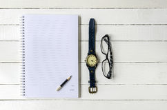 Note book , pencil ,watch and eyes glass Royalty Free Stock Photo