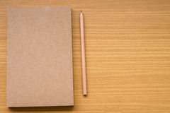 Note book with pencil Stock Photo