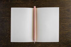 Note book with pencil on a wooden desk Royalty Free Stock Photos