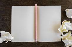 Note book with pencil on a wooden desk Royalty Free Stock Image
