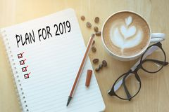 Note book with plan for 2019 word and check marks, pencil and a royalty free stock photo