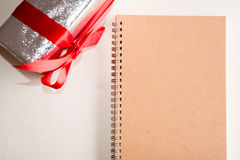 Note book with presents box Stock Photo