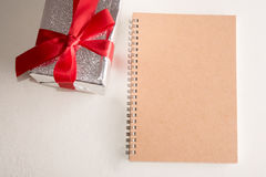 Note book with presents box Stock Photos
