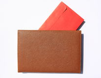 Note book with red envelope inside. On white background Stock Photos