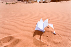 Note book in red sand dune of desert Stock Images