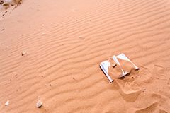 Note book in red sand dune of desert Royalty Free Stock Image