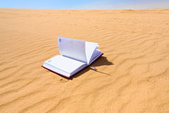Note book in sand dune desert Royalty Free Stock Photos