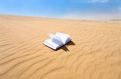 Note book in sand dune desert Stock Image