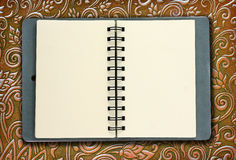 Note Book seats on the sheet alloy Stock Photos
