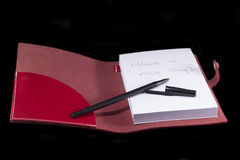 Note book with text Stock Images