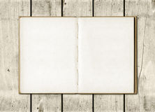 Note book on a white wood background Stock Photos