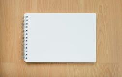 Note book on wood table. Note book on wood table, Sketch book on wood table, White paper on wood table Stock Image