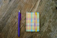 Note book on wooden table with pen note royalty free stock image